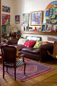 Moon to Moon: Eclectic Sitting Rooms... colorful art on light colored walls