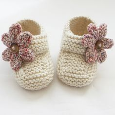 Hand Knitted Baby Shoes-Booties - Folksy folksy.com642 × 642Search by image These special little shoes/booties have been knitted with lovely Sirdar cotton blend yarn. They are adorable in cream with pastel mix knitted flowers finished with tiny buttons. The buttoned...