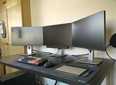 All In Black Gaming Computer Desk Setup With Triple Monitors And Keyboard