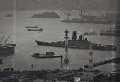 72000 ton , 18 in super battleship Yamato leaving Kure naval base on 6 April 1945 on her last voyage: she was sunk by US naval aircraft during what was effectively a one way suicide mission.