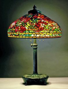 Library lamp, c. 1902. Shade No. 1505, 22 in. Peony design, Holden shape; Standard No. 367, O'Brien design, cushion base, large; leaded glass, bronze; Tiffany Studios, New York City, 1902–32; marks on shade: TIFFANY STUDIOS / NEW YORK; marks on base: TIFFANY STUDIOS / NEW YORK; 32 1/2 in. x 22 in. (69-016).