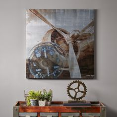 History of Aviation will add the perfect touch of masculinity to your office space. The art features a detailed depiction of airplane propeller printed on canvas with metallic ink.
