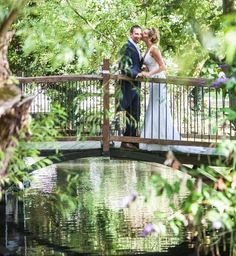 wedding kiss on the bridge to the wedding barn