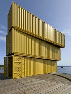 sweco architects' water sports center in denmark is built using recycled containers