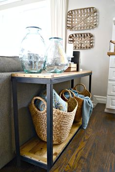 DIY Industrial farmhouse sofa table. Turn a metal shelf into rustic shelving. Find out more at theweatheredfox.com