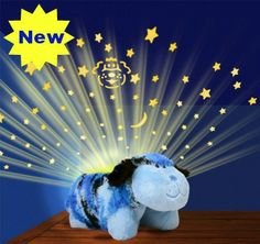 NEW from Pillow Pets, the Dream Lites Camo Dog will make any little boy's bedroom light up with a starry night sky   Features:  • Projects a...