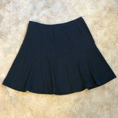 Navy Calvin Klein Skirt This is a classic skirt by Calvin Klein. Has a side zipper. It is made of polyester, viscose and spandex. Size 10. Calvin Klein Skirts A-Line or Full