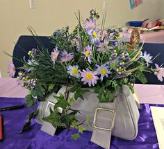 centerpieces at a tea were purses filled with flowers. The lady that made them bought little handbags at Goodwill & repurposed them..how cute!