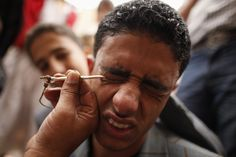 KOHL IN HIS EYE: A man winced as kohl was applied to his eyelids at the Grand Mosque during the Muslim holy fasting month of Ramadan in San'a, Yemen, Sunday. (Khaled Abdullah/Reuters)