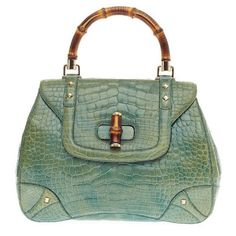 Pre-owned Gucci Bamboo Top Handle Alligator Large (10.430 BRL) ❤ liked on Polyvore featuring bags, handbags, handbags and purses, top handle bags, studded purse, gucci handbags, green leather handbag, gucci purses and alligator purse