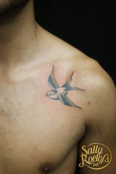 Old school swallow chest tattoo