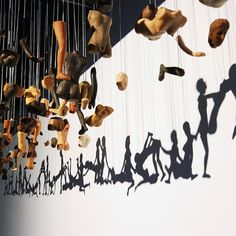 This is just brilliant! Shadow puppetry meets art installation.