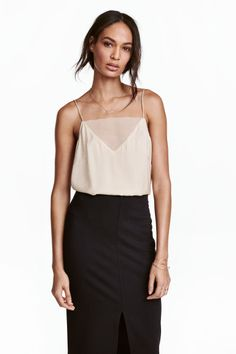 Strappy top with mesh detail: Top in a lightly crêped weave with a sheen. Mesh-covered V-neck at the front, narrow shoulder straps and a rounded, overlocked hem.