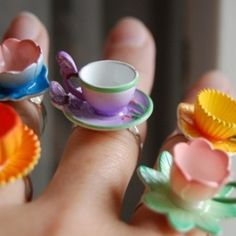 Tiny teacup rings - what a cute tea party favour -- maybe made into napkin rings?
