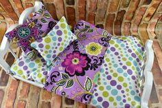 This colorful Floral pattern has so many options! Lively and Bright Purple and Multi Colored coordinating patterns make this a wonderful set for any doll bedding collection. Mattress is gently hand st