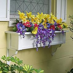 pvc window boxes - I like the brackets, looks more substantial though I think in a darker colour to compliment light grey house and white window