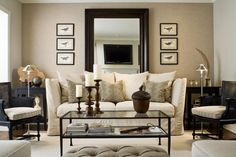 This is a great trick if you have an extra foot or so of space. Pull your sofa out from the wall, and place a piece of furniture behind it. Lean a large piece of art and add accessories and even lamps. This gives some nice depth to the room (and if you're a renter, you're not committed to nail holes in your wall).