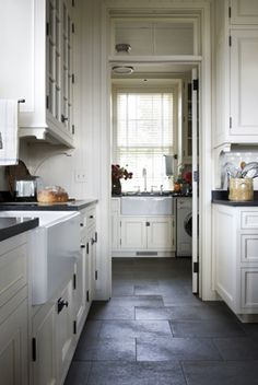 Miles Redd-Transoms above the doors-The Farmhouse sinks are wonderful too-Looks like Kirk stone or slate for counters-