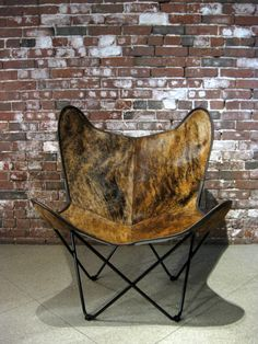 Sculptural and classic, this BKF (butterfly) chair, covered in brindle hide is a timeless and comfortable statement piece.