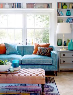 Love the bookshelf over the couch and window!