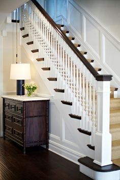 Foyer wainscotting and trim painted in Frostine by Benjamin Moore