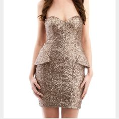 Abyss Gold Peplum Dress Beautiful dress, never worn. In excellent condition! Perfect for New Years Eve. Make me an offer!! Denoted as NWT. Doesn't have a tag but is definitely new and unworn. Abyss Dresses Strapless
