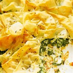 Spinach and feta filo pie recipe - This vegetarian pie costs around per person to make. It's a cheap and cheerful meal that looks more expensive than it is! Moroccan Vegetables, Vegetarian Pie, Spinach And Feta, Dinner Dishes, Mediterranean Recipes, Vegetable Recipes, Family Meals, Cooking Recipes, Yummy Food