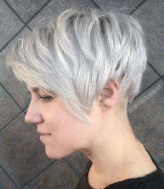 Shiny Silver Undercut Pixie with choppy layers Choppy Silver Pixie - All For Hair Cutes Pixie Haircut For Round Faces, Pixie Cut With Bangs, Longer Pixie Haircut, Blonde Pixie Cuts, Round Face Haircuts, Haircuts For Fine Hair, Short Pixie Haircuts, Haircuts With Bangs, Short Blonde
