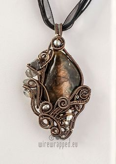 She has some great stuff! - The focal bead is beautiful labradorite, grey with deep pinkish flashes all over the surface