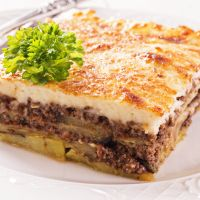 Moussaka Recipe!  Moussaka is a traditional Greek eggplant recipe, with cream béchamel sauce, cinnamon spiced ground meat and layered fried eggplant slices & scalloped potatoes.