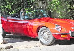 Red winner: The One Direction singer dropped the top on his vintage Jaguar and headed around the area with his sunglasses on