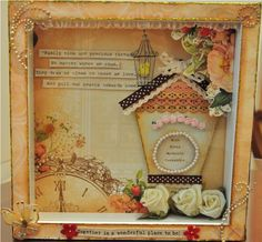Read more @ http://www.thescrapperinme.blogspot.com !  Items used:  -IKEA white photo frame  -Webster pages lullaby collection(love the vintage clock)  -Distress inks - Tattered rose, worn lipstick and tea dye   -Random gold butterfly  -DAISO white roses,lace and pearls  -Prima pearls and tiny tots flowers  -Ribbons from thepapermarket  -Martha Stewart pinking scallop punch  -EK success Jolee's boutique bird cage!