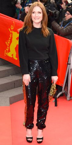 Julianne Moore made quite a statement at the Maggie's Plan premiere during the 66th Berlinale International Film Festival in a playful pair of black sequined pants that she styled with a simple black top, open-toe pumps, and an embellished clutch.