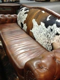 get a leather couch from craigslist free, then reapolster it weith cowhide, wala, new couch!