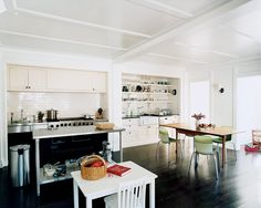 These black floors break up the white walls and give off lots of sheen.