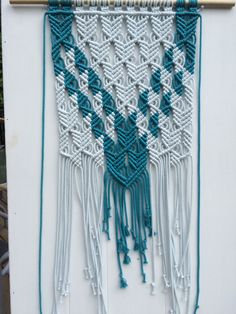 A personal favorite from my Etsy shop https://www.etsy.com/ca/listing/247020535/macrame-wall-hanging-synchronicity