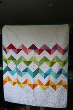 chevron quilt can be sewn with charm squares or strips, depending on the width of the chevron pattern