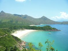 Tai Long Wan (Big Wave Bay) in Sai Kung, Hong Kong.     I've been here. And yes, it really is that beautiful.