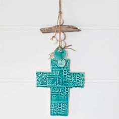 Price: Starting at $39.95   Clay cross handmade in Australia. White earthenware clay glazed with a beautiful turquoise gloss glaze.  Natural twine with clay pebble beads, driftwood and glass make this a beautiful wall hanging.  You can personalise this gift by handwriting a message on the back (unglazed side) with a felt pen.   Available in small, medium and large.  Small: 120mm h x 96mm w, overall drop length 300mm Medium: 175mm h x 130mm w, overall drop length 400mm Large: ...
