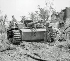 British soldiers examine two direct hits that took out a German Stugg SP gun.