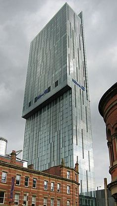 "Beetham Tower, Manchester, UK. Ian Simpson. I like the ominous feel of this building and how it towers over everything that surrounds it. I get an ""evil corporation"" feel from this building. I like striations on the facade it adds to the already linear feel of the structure. The color of the exterior also complements the clouds, and since it is in the UK then that means it fits in well most of the time."