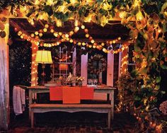 perfect outdoor dining area -- intimate and cozy with the lighting and plants