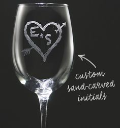 Make wine-sipping an even more regal affair (yes, it is possible) with this set of custom wine glasses. Each wine glass is deeply engraved with carved initials, surrounded by a heart and arrow. It's like carving your initials into a tree, but much classier. And with wine.