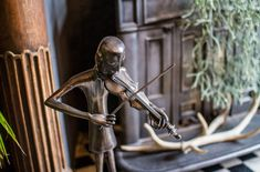 André's house is full of interesting objects, including this neat statuette. Photo: Lloyd Stas