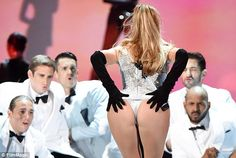 Look at the girl: JLo got some attention from the men backing her up