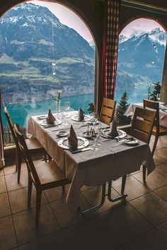 The dining room of Hotel Bellevue overlooking Lake Lucerne and the Swiss Alps // Lucerne, Switzerland