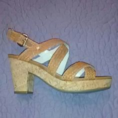 Size 10 Brown Dana Buchman Sandals Super cute Brown Dana Buchman sandals with Gold buckle. Only worn once very comfortable. 1 inch platform three and a half inch heel. Dana Buchman Shoes Sandals