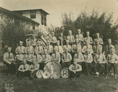 Rice Institute Band group photograph with owl hats, 1921