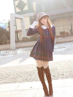 Cute, gyaru: Light gray hat. White gloves. Pleated, navy dress with white buttons and white collar. Brown, thigh-high boots.                                                                                                                                                      More