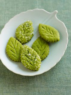 "Matcha Tea Leaf Shortbreads. ""I totally give you permission to make them into a different shape. And if you're going through the process of sanding them with sugar and lightly rolling them to help it adhere -- thus making it unfavourable (note I used the UK spelling! Psych!) to re-roll and re-cut after the first go-round, try cutting into squares and then mini triangles, using all the dough."" -Cas"
